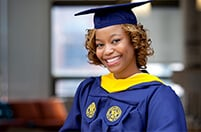 Female Drexel graduate wearing cap and gown